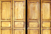 Wooden door in old style — Stock Photo