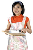 Young girl cooking, cutting — Stock Photo