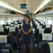 Постер, плакат: Female attendant in train China