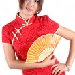 chinese girl in traditonal dress with fan — Stock Photo