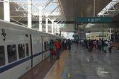 Passengers enter train, China — Photo