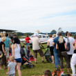 Stock Photo: Air show - visitors admire planes