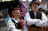 Traditional uniform - folk dancers — Stock Photo