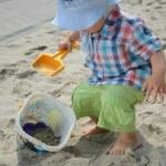 Постер, плакат: Baby boy in sandpit