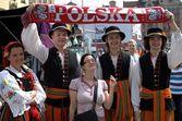 Folk dancers with football fan — Stock Photo