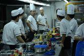 Chinese restaurant - chefs in kitchen — Stock Photo
