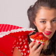 Girl eating strawberry pie — Stock Photo #19891577
