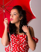 Pin up with umbrella — Stock Photo