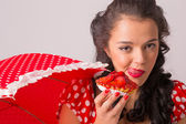 Girl eating strawberry pie — Stock Photo
