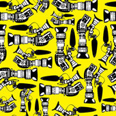 Cameras on yellow background seamless pattern — Stock Vector