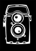 Vintage film photo camera isolated on black background — Stock Photo