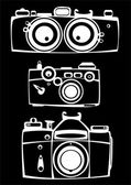 Set of three vintage film photo cameras isolated on black backgr — Zdjęcie stockowe