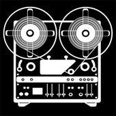 Reel tape recorder on black background — Stock Photo