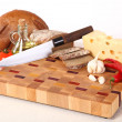 Vegetables, cheese and bread on a chopping board — Stok fotoğraf