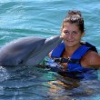 Dolphin kisses woman — Stock Photo
