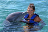 Dolphin kisses woman — Stock Photo