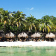 Stock Photo: Tables on beach with thatched umbrellas