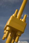 Heavy duty nuts and bolts of a yellow bridge — Stock Photo