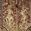 Traditional wood carving on a Balinese door, Indonesia — Stock Photo #19281597