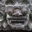 Balinese temple sculpture is guarding the temple - Stock Photo