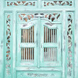 Traditional Indonesian wood carved window with shutters — Stock Photo