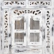 Traditional Indonesian wood carved window with shutters — Stock Photo #19281875