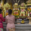 Preparing offerings for a temple ceremony in Bali - Stock Photo