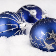 Blue Christmas ornaments in the snow — Stock Photo