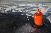 Ice landscape with orange buoy and floes — Stock Photo