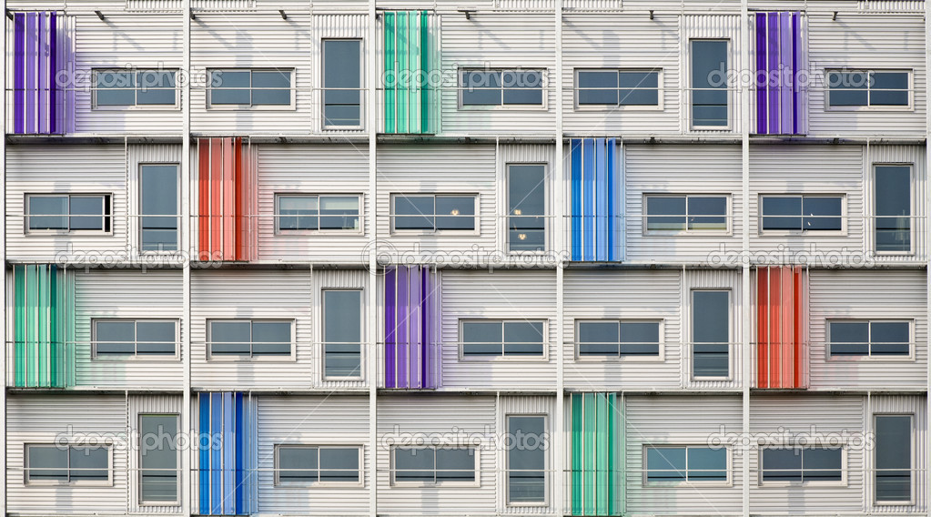 multi colored facade of a modern building stock photo erikdegraaf 19282497. Black Bedroom Furniture Sets. Home Design Ideas