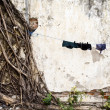 Stock Photo: Hanging clothes in slum arein Jakarta, Indonesia