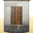 Window with closed shutters in Canarian architecture, Gran Canaria - Stock Photo
