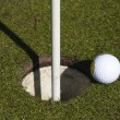 So close. golf ball close to hole — Foto Stock