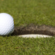 Stock Photo: So close. golf ball close to hole