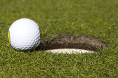 So close. golf ball close to hole — Stock Photo