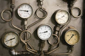 A decayed panel of gauges — Stock Photo