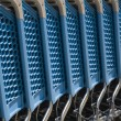 Blue plastic shopping carts in a row — Stock Photo