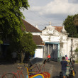 Stock Photo: Street scene with becak in Kraton arein Solo