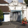 Stock Photo: Street scene with becak in Kraton arein Solo, Indonesia