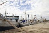 Makassar schooners (pinisi) in Paotere harbor, the old port of Makassar, — ストック写真