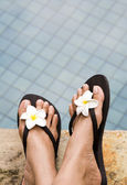 Relaxing on the side of the swimming pool — Stock Photo