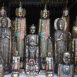 Woodcarved buddha's for sale in a shop — Stock Photo