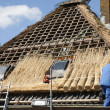 Stock Photo: Workmen thatching new roof