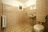 Old empty bathroom with brown tiles — Stok fotoğraf