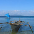 Fishing boats in Puerto Galera, Philippines - Stock Photo