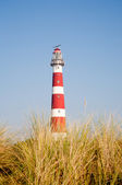 Iconic red and white lighthouse in the dunes of Ameland, the Netherlands — Stock Photo