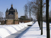 Dutch castle in a winter landscape — Stock Photo