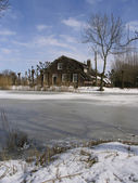 Old Dutch farm house in winter landscape — ストック写真