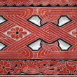 Red woodcarved, Indonesian wall — Stock Photo