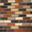 Brick wall background of various colored bricks — Stock Photo